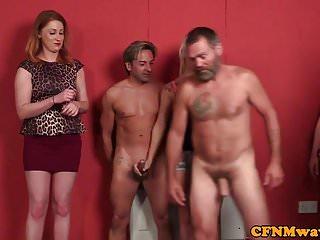 British femdoms tugging guys in cfnm group