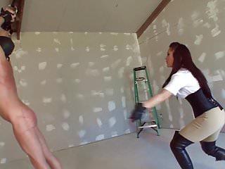 Brunette mistress whips her slave