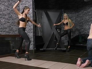 Mistress Ariel and Amanda Whipping a Slave Violently.