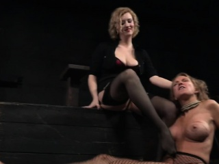 Restrained busty milf pissing in bdsm action