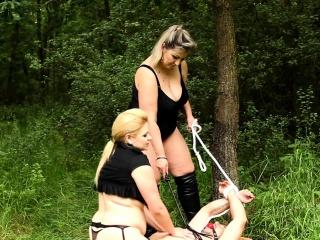 Curvy dominatrix babes enjoy outdoor sex