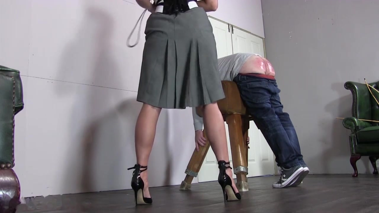 Hot blonde strict mistress caning her slave