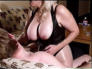 Sexy dominating powerful Goddess Sondra  her young sex slave's rock hard cock inside her. He has no escape, bond to a chair by rope, his only hope is to satisfy her. Smoking her Saratoga 120 cig