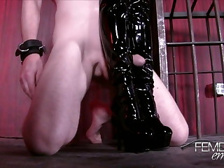 On the Compound slaves are not permitted to have sex. Lexi takes takes advantage of the slaves desperately horny state and orders him to his knees to hump her boot like a dogg.