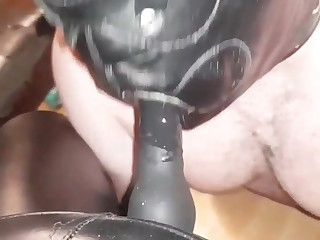 The Boss forces the sissy slave to service her rubber cock