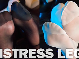 Mistress feet in black and white stockings. Nylon soles close ups. Feel my nylon feet right at your face. Sniff deeper and enjoy how they are soft and warmthy. You are slave of my pretty feet. Prepare