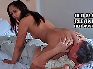 Slave laps away at shaved pussy and ass