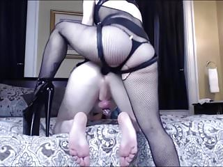 Domme pegging guy in chastity